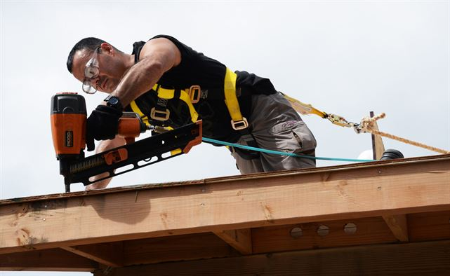Roofing nail gun in action